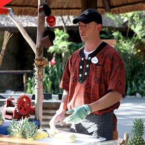 12 of 27: Disney's Animal Kingdom - Pineapple cutting demonstration in Harambe Fruit Market