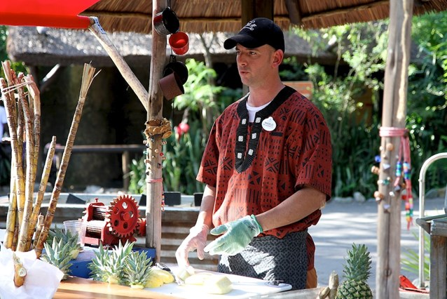 Disney's Animal Kingdom - Pineapple cutting demonstration in Harambe Fruit Market
