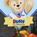 Character Meet and Greets at Epcot - Duffy signs everywhere on opening day at Epcot's World Showcase