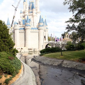1 of 20: Cinderella Castle - A totally drained castle moat and crane working on the Dream Light removal