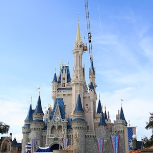 1 of 8: Cinderella's Holiday Wish - Cinderella's Holiday Wish lights installation - crane onsite