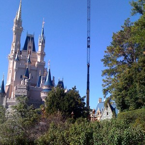 1 of 3: Cinderella's Holiday Wish - Crane onsite removing the Castle Dream Lights