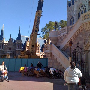 2 of 3: Cinderella's Holiday Wish - Crane onsite removing the Castle Dream Lights
