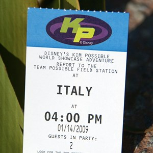 5 of 16: Disney's Kim Possible World Showcase Adventure - A closeup of the FASTPASS type ticket giving the time and location of your adventure.
