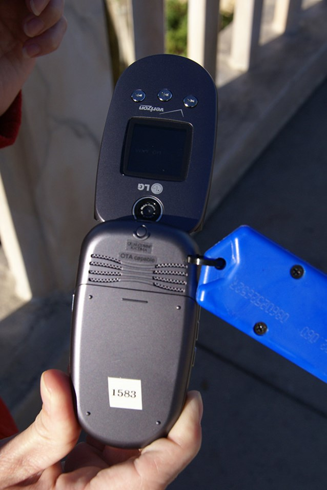 Disney's Kim Possible World Showcase Adventure - The backside of the LG clamshell flip phone.