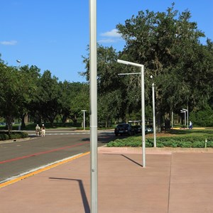 1 of 2: Epcot - What Will You Celebrate signs down at park entrance