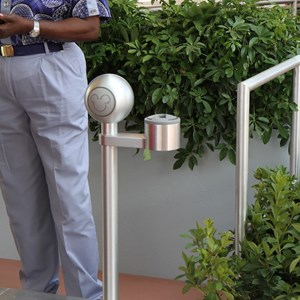 3 of 7: Epcot - The RFID reader - note the Cast Member holding a portable device which presumably allows the Cast Member to see details of the ticket being scanned