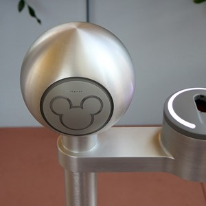 4 of 7: Epcot - Close-up of the RFID reader - the Mickey head lights up green when successfully read, the finger scanner is on the right