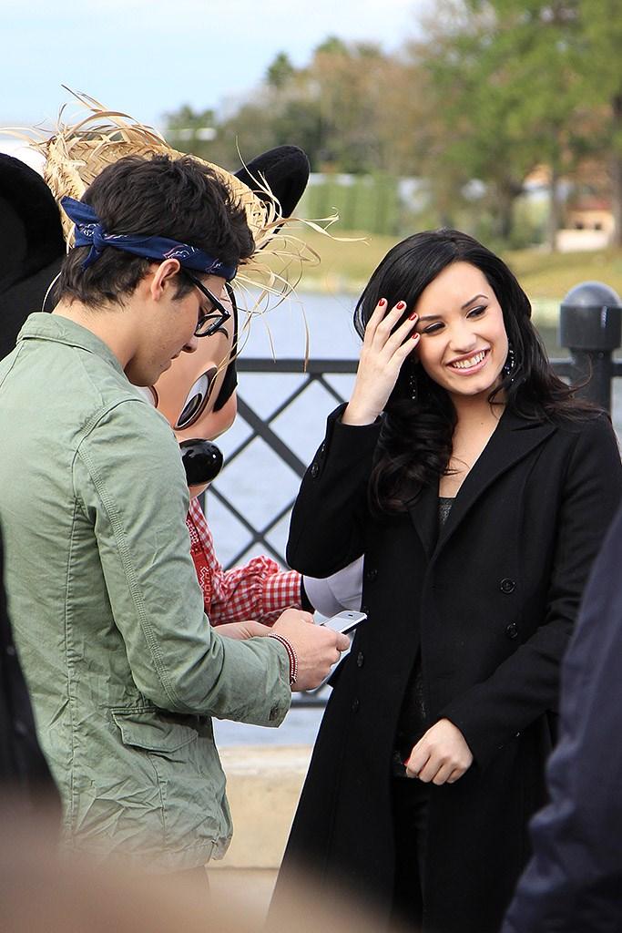 Celebrities Demi Lovato and Joe Jonas at Epcot