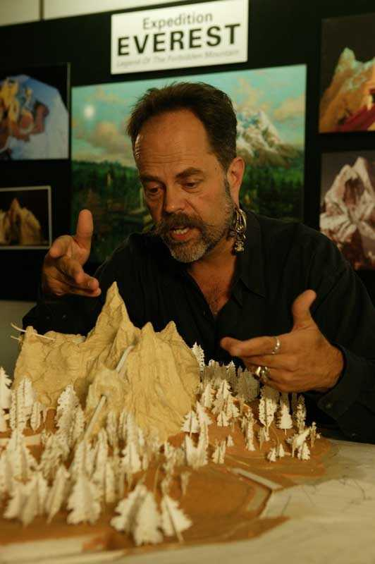 Joe Rohde with a model of Expedition Everest
