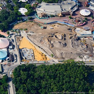 1 of 1: Fantasyland - Fantasyland aerial photo showing construction of the Little Mermaid attraction and ground clearing for the other expansion areas