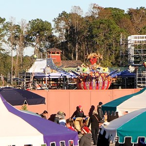 1 of 2: Fantasyland - Dumbo takes to the skies - notice the rider in the white construction hat on the left side