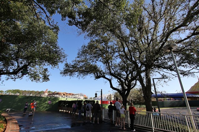 Fantasyland - A small crowd gathers at park opening for a possible soft opening