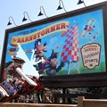 Fantasyland - A train crashing through the billboard