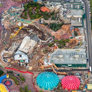 1 of 8: Fantasyland - Beauty and the Beast in the upper right, Storybook Circus in the bottom right, Snow White Mine Train coaster in the center.