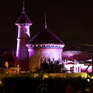 3 of 4: Fantasyland - NIghttime lighting at Prince Eric's Castle at the LIttle Mermaid