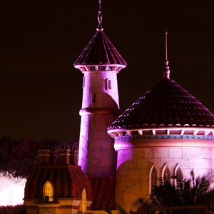 4 of 4: Fantasyland - NIghttime lighting at Prince Eric's Castle at the LIttle Mermaid