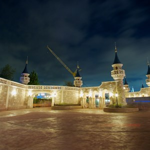 6 of 17: Fantasyland - Fantasyland castle walls nighttime lighting