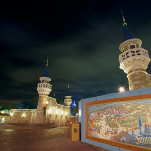8 of 17: Fantasyland - Fantasyland castle walls nighttime lighting
