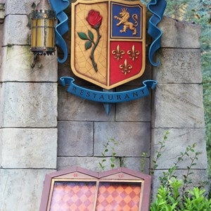 10 of 40: Fantasyland - New Fantasyland Enchanted Forest - Be Our Guest Restaurant entrance sign and menu board