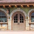 Fantasyland - New Fantasyland Enchanted Forest - Closeup of Bonjour Village Gifts inside Belle's Village