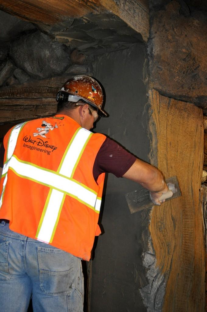 Imagineers work on the Seven Dwarfs Mine Train rockwork