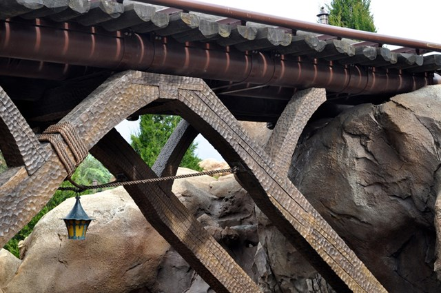 Bridge crossing the stream at the Seven Dwarfs Mine Train coaster