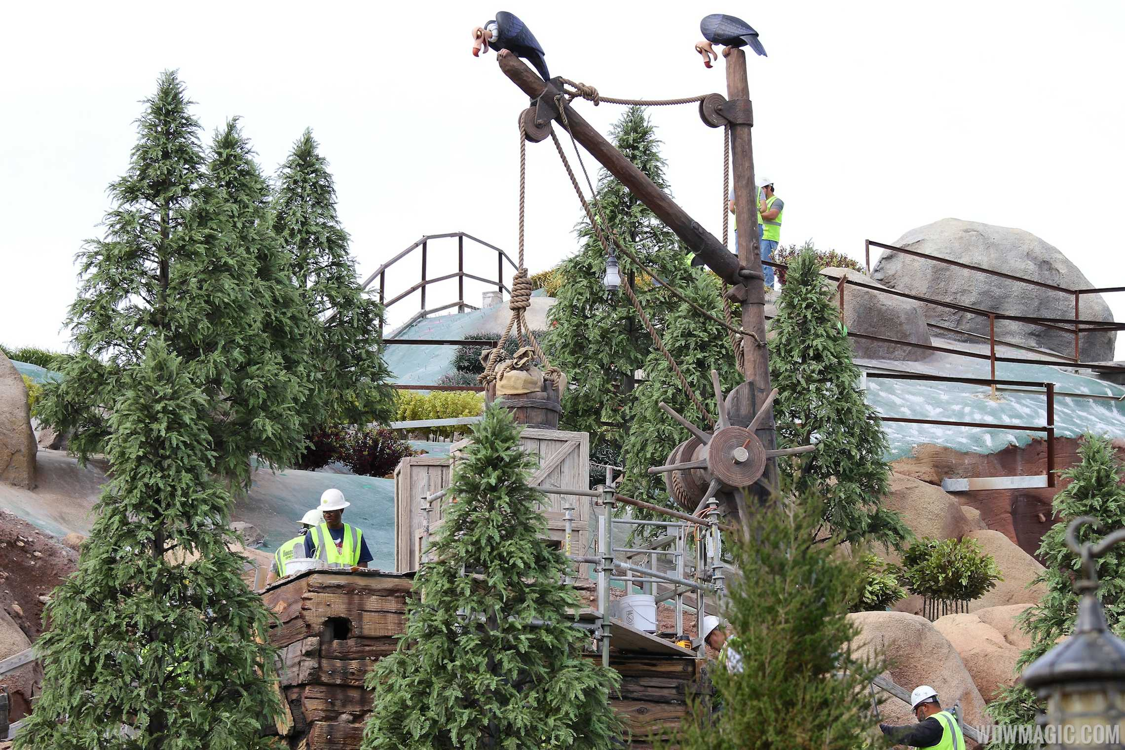 Crews working on landscaping at the Seven Dwarfs Mine Train coaster