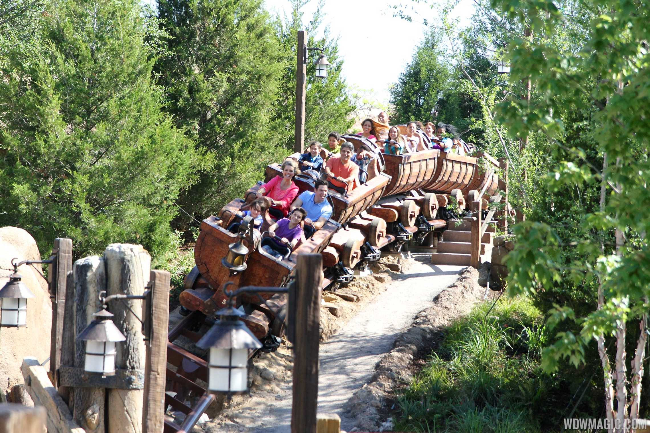 Actors ride the Seven Dwarfs Mine Train coaster