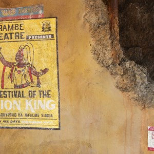 36 of 40: Festival of the Lion King - New Harambe Theatre area in Africa - Wall art on the restrooms
