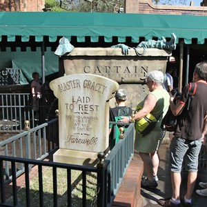 14 of 24: Haunted Mansion - Master Gracey tombstone in the center of the new queue