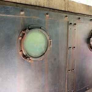 22 of 24: Haunted Mansion - The portholes on the back of the Captain's tomb