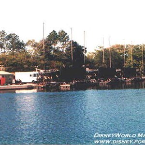18 of 37: IllumiNations - The Maxi Barges parked in the marina. The pyro compound is just to the left.
