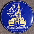 Magic Kingdom - 40th buttons handed out to guests at the turnstiles
