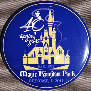 12 of 12: Magic Kingdom - 40th buttons handed out to guests at the turnstiles