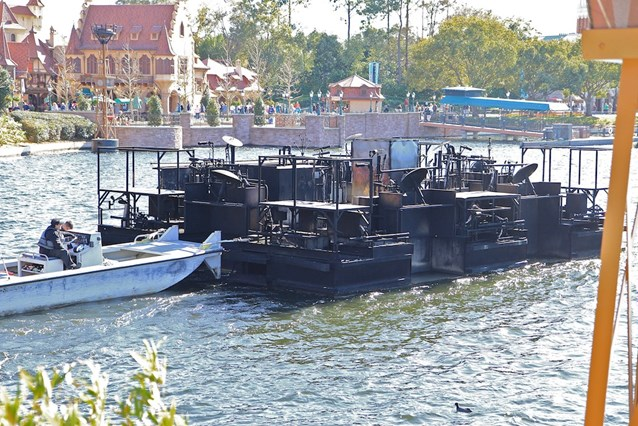IllumiNations: Reflections of Earth - The inferno barge passing through the bridge