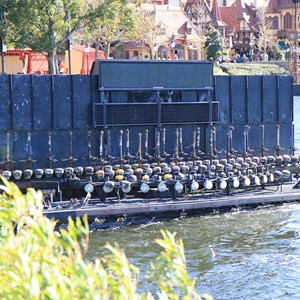 4 of 4: IllumiNations: Reflections of Earth - A maxi fountain barge heading into the lagoon