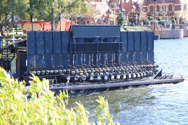 IllumiNations: Reflections of Earth - A maxi fountain barge heading into the lagoon