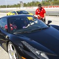 Richard Petty Driving Experience - Pit crew loading a guest into the Ferrari