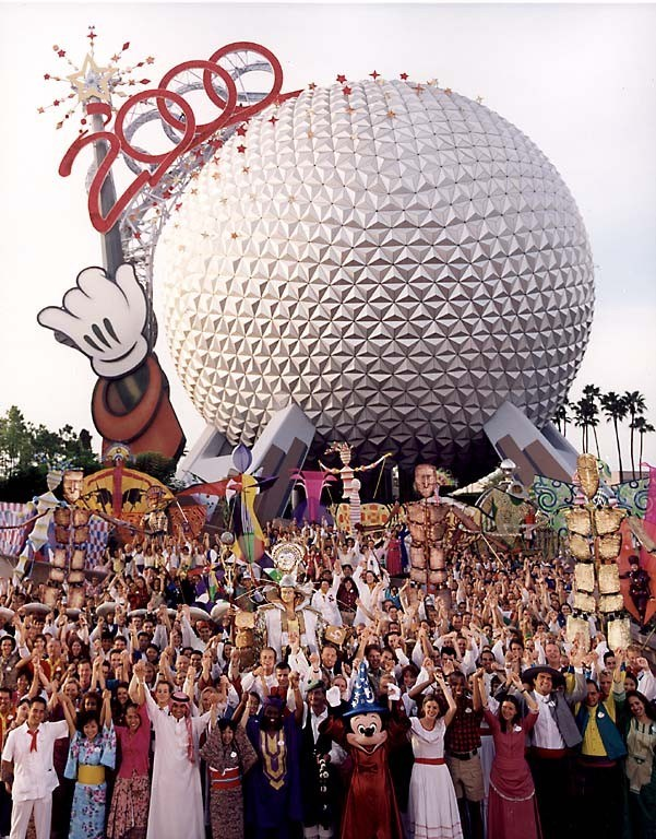 Cast pose infront of the new Epcot icon