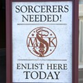 Sorcerers of the Magic Kingdom - Sorcerers Needed! signage infront of the Fire House