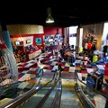 Splitsville - Splitsville upper level escalator down to lower level lobby