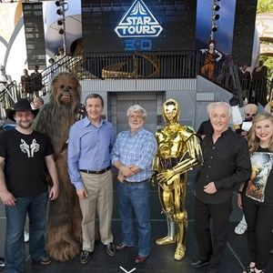 "1 of 4: Star Tours - The Adventures Continue - Walt Disney Co. president and CEO Bob Iger (fourth from left) poses with ""Star Wars"" creator George Lucas (fifth from left), ""Star Wars"" celebrities and ""Star Wars"" characters May 20, 2011 at Disney's Hollywood Studios"