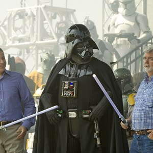 "2 of 4: Star Tours - The Adventures Continue - Walt Disney Co. president and CEO Bob Iger (left) and ""Star Wars"" creator George Lucas (right) join ""Star Wars"" villain Darth Vader (center) May 20, 2011 at Disney's Hollywood Studios"
