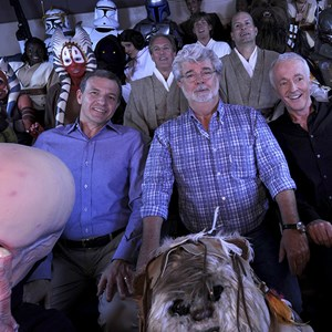"4 of 4: Star Tours - The Adventures Continue - Walt Disney Co. president and CEO Bob Iger (left) ""Star Wars"" creator George Lucas (center) and actor Anthony Daniels, who portrayed C-3PO in ""Star Wars"" (right), pose with ""Star Wars"" characters May 20, 2011 inside a ""Star Tours"" ride vehicle at Disney's Hollywood Studios"