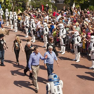 "3 of 4: Star Tours - The Adventures Continue - Walt Disney Co. president and CEO Bob Iger (left) waves as he walks with ""Star Wars"" creator George Lucas through Disney's Hollywood Studios theme park"