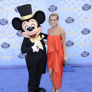 "16 of 19: The American Idol Experience - Singer Carrie Underwood, the winner of Season 4 of the hit TV show ""American Idol,"" poses Feb. 12, 2009 with Mickey Mouse during the grand opening of ""The American Idol Experience"". Photo Copyright The Walt Disney Company 2009."