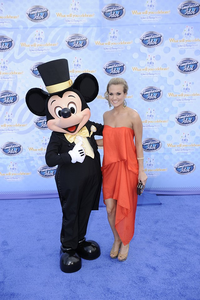"The American Idol Experience - Singer Carrie Underwood, the winner of Season 4 of the hit TV show ""American Idol,"" poses Feb. 12, 2009 with Mickey Mouse during the grand opening of ""The American Idol Experience"". Photo Copyright The Walt Disney Company 2009."