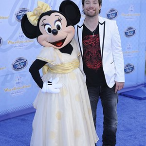 "17 of 19: The American Idol Experience - Singer David Cook, the winner of Season 7 of the hit TV show ""American Idol,"" poses Feb. 12, 2009 with Minnie Mouse during the grand opening of ""The American Idol Experience"" . Photo Copyright The Walt Disney Company 2009."