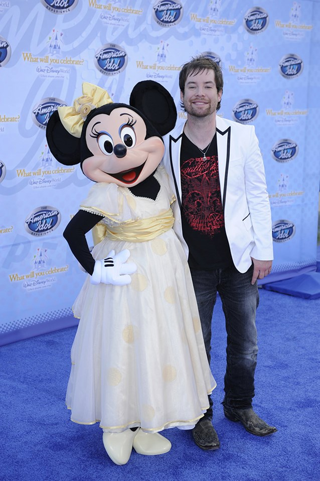 "The American Idol Experience - Singer David Cook, the winner of Season 7 of the hit TV show ""American Idol,"" poses Feb. 12, 2009 with Minnie Mouse during the grand opening of ""The American Idol Experience"" . Photo Copyright The Walt Disney Company 2009."